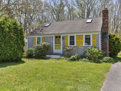 Photo for Cozy cottage w/ a furnished patio & backyard playset - walk to the harbor!