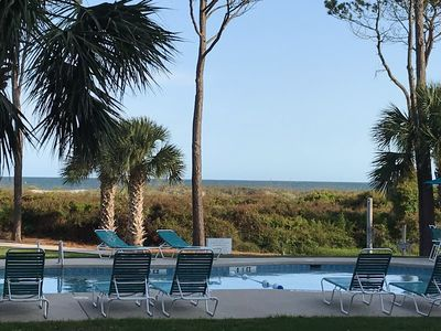 View from the porch--we overlook the pool , and yes, that's the ocean in back.