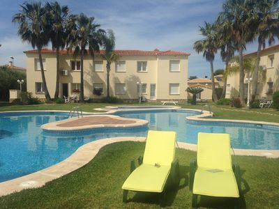 Photo for Poolside garden apartment, moments from stunning beach & 18 hole golf course