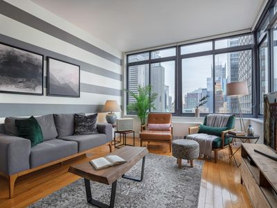 Photo for Modern + Bright Times Square 1BR w/ Indoor pool by Blueground