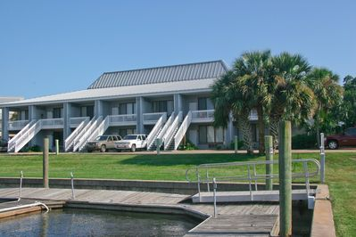 Front view of condos, taken from decking around the marina area.