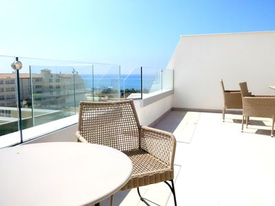 Photo for Bright colors, blue sea and large roof terrace