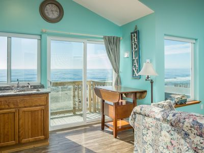 Photo for Two bedroom upstairs condo with WiFi, fireplace, kitchen, ocean balcony