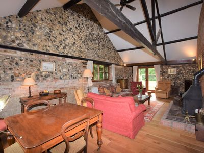 Lounge with comfrotable sofas & woodburner
