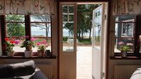 Fantastic location just at the wide sandy Beach. You hear waves from the large wooden terrace.