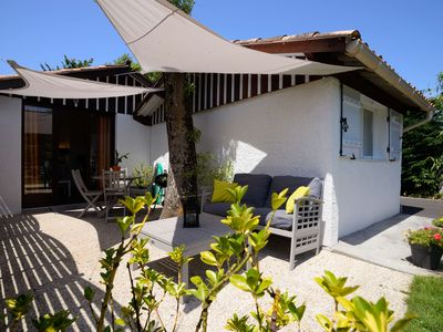 Photo for Wood chalet with garden 3 miles away from the Pyla dune and Arcachon