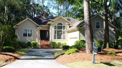 This great home is private but not far from the action on Seabrook!