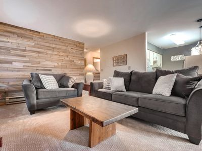 Photo for Spacious & open family friendly 2 bdrm on bus line w hot tub & fireplace!