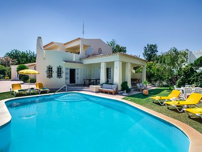 Photo for Beautiful Spacious 7 Bedroom Villa Amendoeira, Large Garden And Private Pool