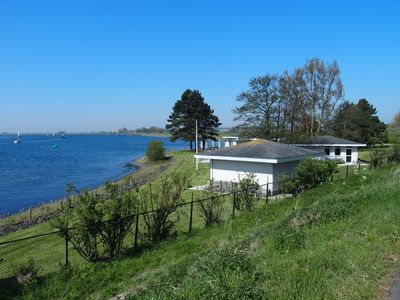 Photo for Atmospheric holiday home in Kortgene, directly on t Veerse Meer, own jetty