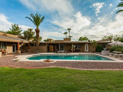 Photo for Luxurious 5 bed 4 bath house with a large HEATED POOL and backyard