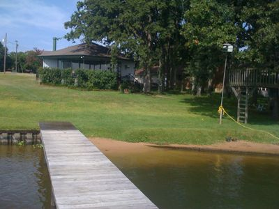 Photo for Charming lake house with sandy beach - walking distance to Lone Star Marina
