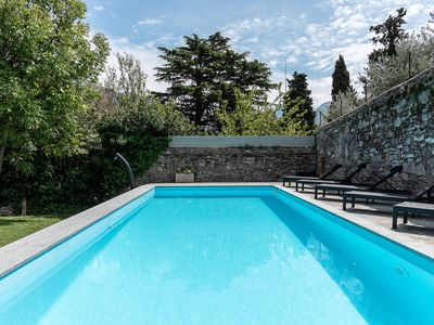 Photo for Fabulous villa with private pool set in beautiful garden overlooking the lake