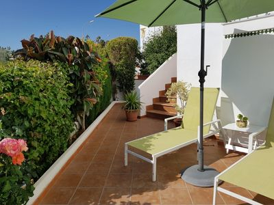 Photo for Apartment with garden/terrace and sea view, close to the beach, sleeps 4.