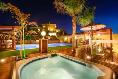 Jacuzzi and outdoor pool area