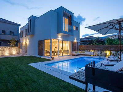 Photo for Koras Villa - Modern designed villa with heated pool - few steps from the beach