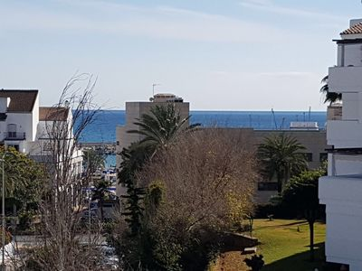 Photo for Apartment sea view, bright, cozy, facing the port, swimming pool, parking, wifi.