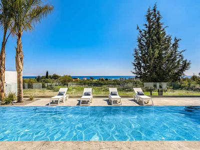 Photo for Brand new 3 bedroom villa on one level, stunning sea views and 10 minutes walk to restaurants, shops and beach. Stylish and elegant design with elogonated oblong swimming pool.