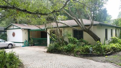Photo for Pet Friendly home with huge back yard on the water 2 blocks from golf course