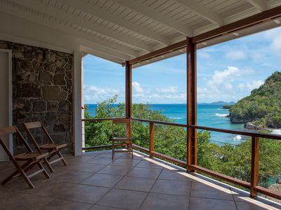 Photo for Secluded villa overlooking black sand beach