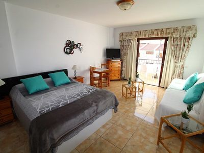 Photo for Large studio with large terrace and beautiful view pool and solarium private parking