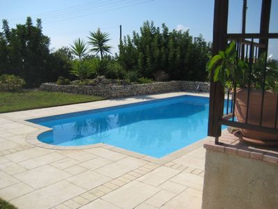 Photo for A charming villa set in beautiful gardens with panoramic sea views. 50% off wk 3