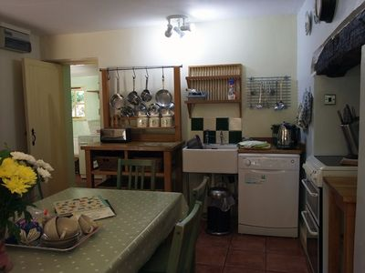 Country style kitchen with all the mod cons - double oven, dishwasher, microwave