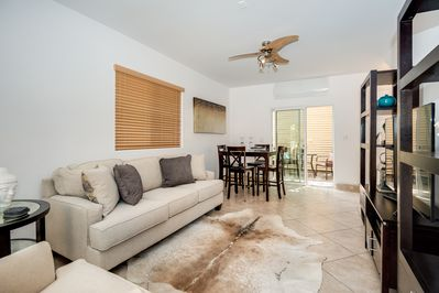 """Living room with 60"""" Flat screen TV incl Cable. Dining Table for 4 & Kitchenette"""