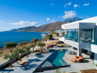 Photo for Sea front 6 bedroom villa with infinity pool and jacuzzi in southeast Crete