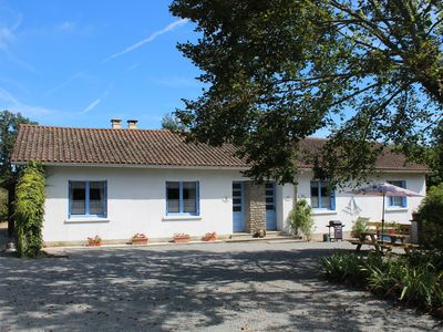 Photo for Family friendly gite near Rochechouart, with heated pool and fishing lake