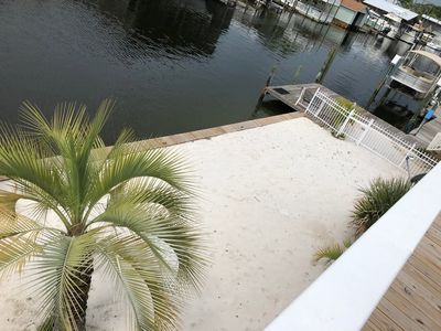 Photo for NEW LISTING~Canal Front~Sleeps 10~ Private Boat slip~Close to Beach/Ent/Food!