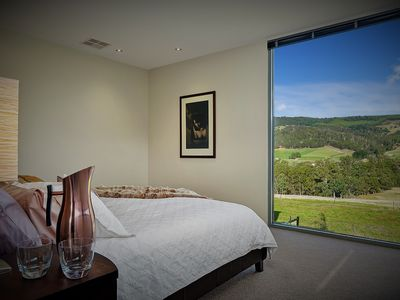 Photo for Wake up at Highland Getaway to spectacular views from a luxurious king bedroom.