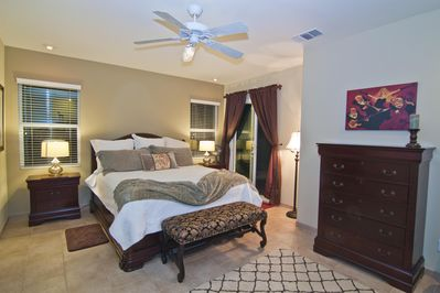 Large Mater Bedroom, King bed with sliding door access to hot tub, pool and view