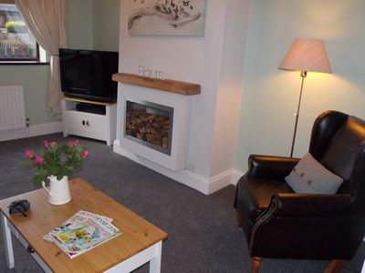 Lounge with Freeview TV, surround sound, DVD player and a selection of DVD's