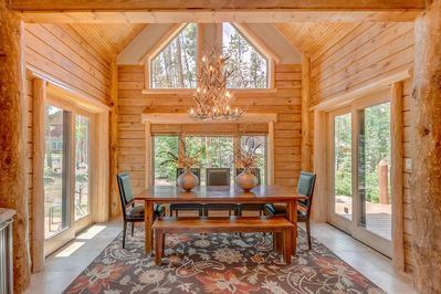 Dining Room with antler chandelier, ski run, mountain views out the door