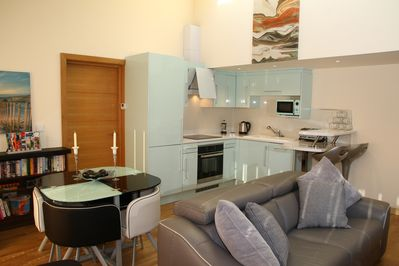 Open plan living, diner, kitchen with comfy sofa