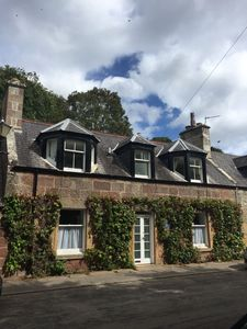 Photo for Traditional stone cottage in the heart of Dornoch