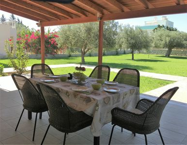 A table at the terrace with the view of our beautiful garden.Enjoy your meals !