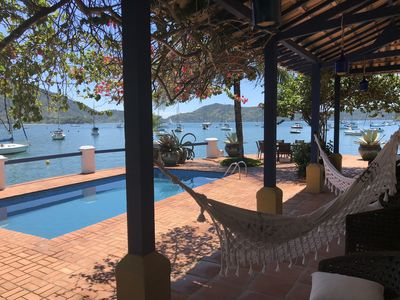 Photo for Foot in the sand, private beach, pool, barbecue, stunning view.