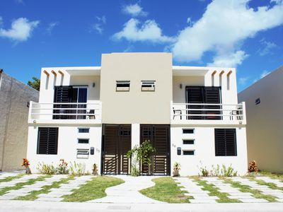Photo for Beautiful condo in a secured community! Close to Cancun! 5 min drive to beach!