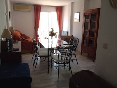 Large bright lounge/ dining room patio doors to sunny terrace. Air con  provided