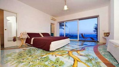 Bedroom with air conditioning, private bathroom with shower, terrace ocean view