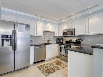 Photo for FREE DAILY ACTIVITIES!!! FREE WIFI!!! Enjoy your vacation at this beautifully renovated one bedroom first floor condo steps from the beach.