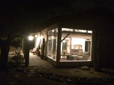 View of the Casita at night.  Living area has two large windows for views.
