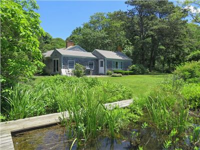 Photo for On the water in Chatham! Private, serene pond front cottage.