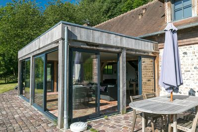 The glass extension adds a touch of modernity to this old building.