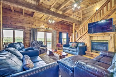 With 6 bedrooms and 3 bathrooms, this cabin accommodates up to 24 guests.