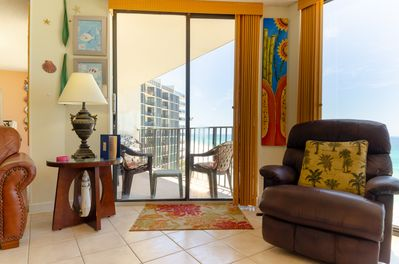 Floor to ceiling windows and sliding doors give you a a broad view of the shimmering white sands and emerald waters of the Gulf of Mexico.