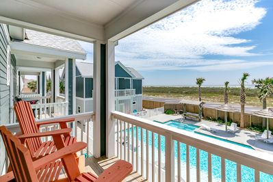 Balcony - Welcome to Corpus Christi! The master bedroom balcony overlooks the pool and dunes. The beach is a short walk from this coastal townhouse!