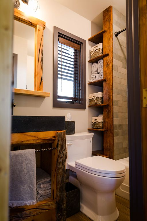 bathroom with soapstone cabin in the pines artfully renovated homeaway green